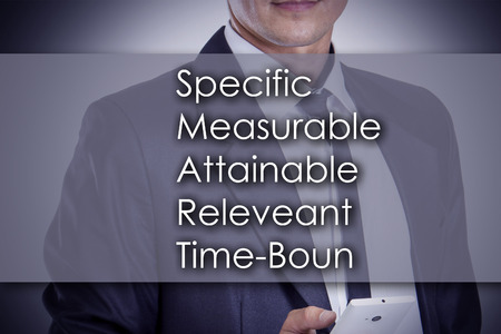 specific: Specific Measurable Attainable Releveant Time-Bound SMART - Young businessman with text - business concept - horizontal image