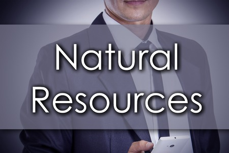 manege: Natural resources - Young businessman with text - business concept - horizontal image