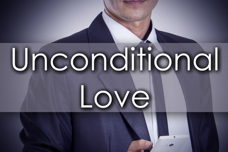 unconditional: Unconditional Love - Young businessman with text - business concept - horizontal image Stock Photo