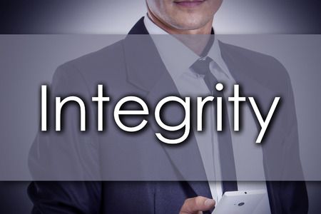 Integrity - Young businessman with text - business concept - horizontal image Stock Photo