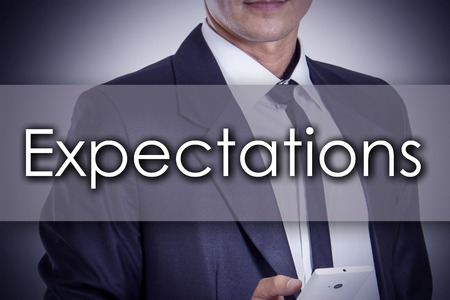 expect: Expectations - Young businessman with text - business concept - horizontal image Stock Photo