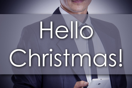 Hello Christmas! - Young businessman with text - business concept - horizontal image Stock Photo