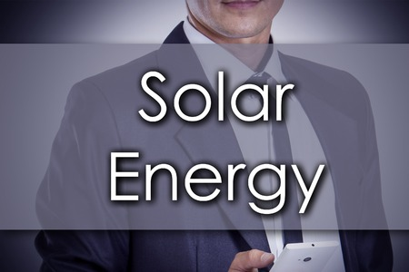environmental suit: Solar Energy - Young businessman with text - business concept - horizontal image