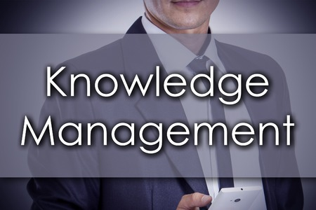 knowledge business: Knowledge Management - Young businessman with text - business concept - horizontal image