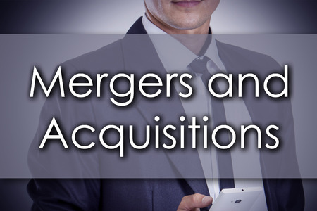 Mergers and Acquisitions - Young businessman with text - business concept - horizontal image Stock Photo