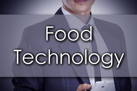 finger fish: Food technology - Young businessman with text - business concept - horizontal image