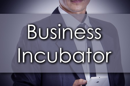 incubation: Business Incubator - Young businessman with text - business concept - horizontal image