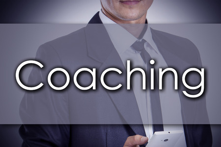 Coaching - Young businessman with text - business concept - horizontal image