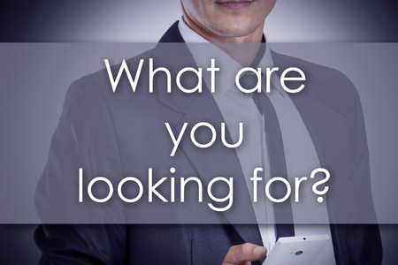 What are you looking for? - Young businessman with text - business concept - horizontal image Reklamní fotografie