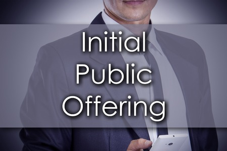Initial Public Offering - Young businessman with text - business concept - horizontal image Stock Photo