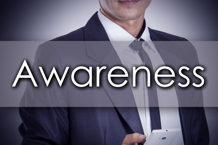 be the identity: Awareness - Young businessman with text - business concept - horizontal image