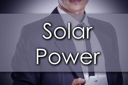 environmental suit: Solar Power - Young businessman with text - business concept - horizontal image