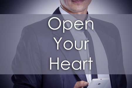 Open Your Heart - Young businessman with text - business concept - horizontal image