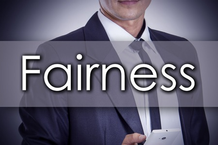 justness: Fairness - Young businessman with text - business concept - horizontal image