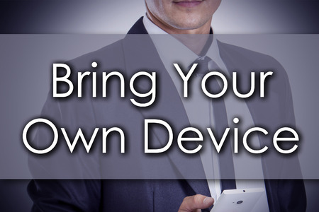 Bring Your Own Device BYOD - Young businessman with text - business concept - horizontal image Stok Fotoğraf