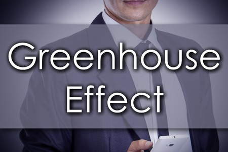 environmental suit: Greenhouse Effect - Young businessman with text - business concept - horizontal image Stock Photo