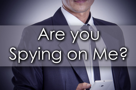 spying: Are you Spying on Me? - Young businessman with text - business concept - horizontal image Stock Photo
