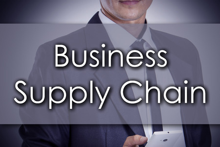 scm: Business Supply Chain - Young businessman with text - business concept - horizontal image