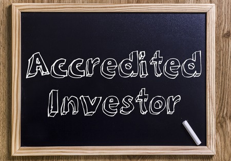 Accredited Investor - New chalkboard with outlined text - on wood Stock Photo