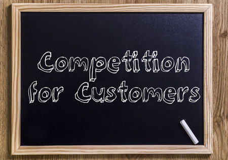 Competition for Customers - New chalkboard with outlined text - on wood Stock Photo