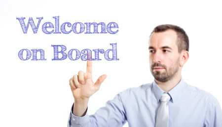 Welcome on board Young businessman with small beard touching text - horizontal image Stok Fotoğraf