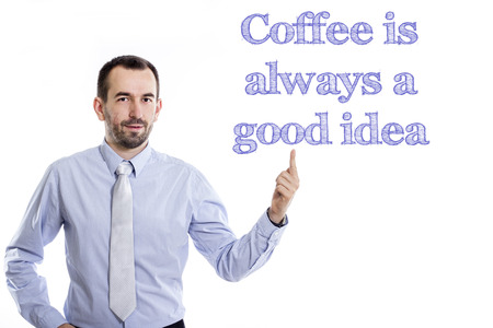 Coffee is always a good idea - Young businessman with small beard pointing up in blue shirt - horizontal image