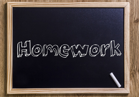 Homework - New chalkboard with outlined text - on wood Stock Photo