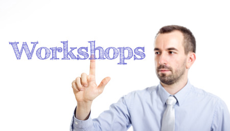 Workshops Young businessman with small beard touching text - horizontal image