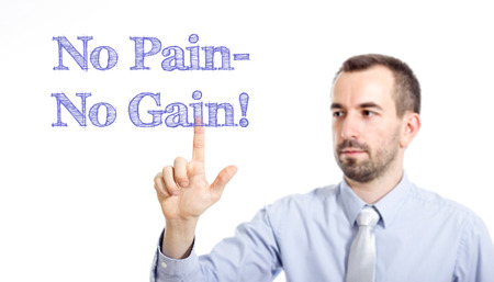 No Pain no gain Young businessman with small beard touching text - horizontal image Stock Photo