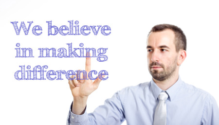 We believe in making difference Young businessman with small beard touching text - horizontal image
