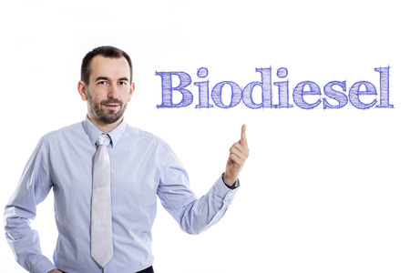 Biodiesel - Young businessman with small beard pointing up in blue shirt - horizontal image