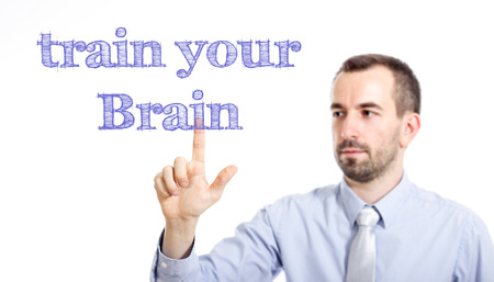 train your brain Young businessman with small beard touching text - horizontal image Stok Fotoğraf