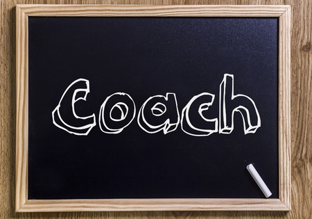Coach - New chalkboard with outlined text - on wood Stock Photo