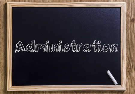 Administration - New chalkboard with outlined text - on wood Stock Photo