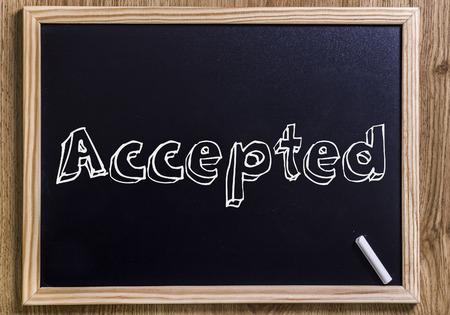 Accepted - New chalkboard with outlined text - on wood Stock Photo