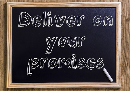 Deliver on your promises - New chalkboard with outlined text - on wood
