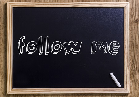 Follow me - New chalkboard with outlined text - on wood Stock Photo
