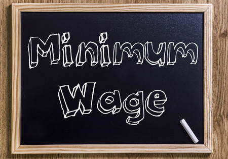 Minimum Wage - New chalkboard with outlined text - on wood Imagens
