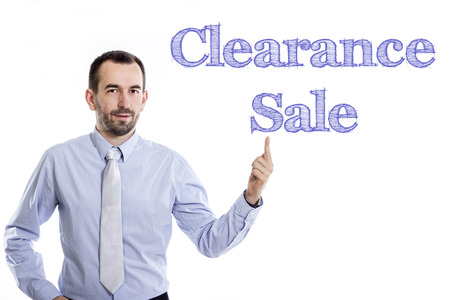 Clearance Sale - Young businessman with small beard pointing up in blue shirt - horizontal image