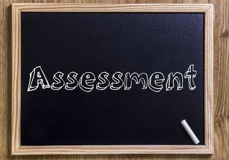 Assessment - New chalkboard with outlined text - on wood Reklamní fotografie