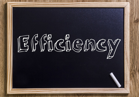 Efficiency - New chalkboard with 3D outlined text - on wood Stock Photo