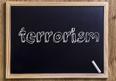 terrorism - New chalkboard with 3D outlined text - on wood Stock Photo