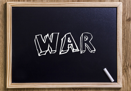 WAR - New chalkboard with 3D outlined text - on wood Stock Photo