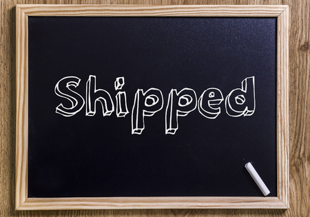 Shipped - New chalkboard with 3D outlined text - on wood Stock Photo