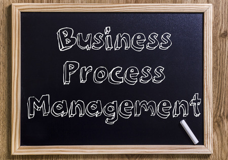 Business Process Management BPM - New chalkboard with outlined text - on wood Stock Photo