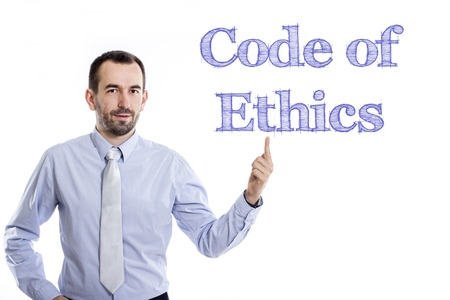 Code of Ethics - Young businessman with small beard pointing up in blue shirt - horizontal image 写真素材