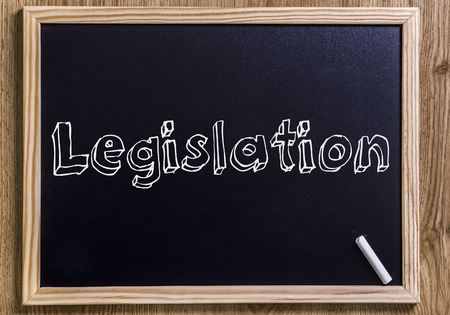 lawmaking: Legislation - New chalkboard with outlined text - on wood Stock Photo