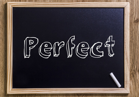 Perfect - New chalkboard with 3D outlined text - on wood Stock Photo