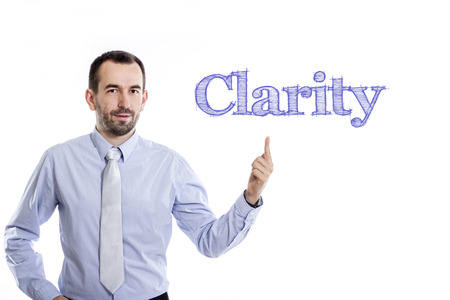 Clarity - Young businessman with small beard pointing up in blue shirt - horizontal image 写真素材