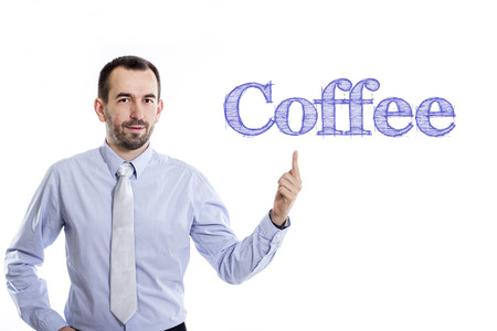 Coffee - Young businessman with small beard pointing up in blue shirt - horizontal image
